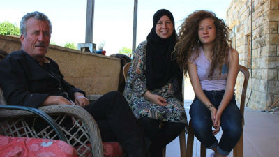 Ahed with her parents Nariman and Bassem Tamimi
